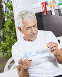 Patient Looking At Pill In Rehab Center Stock Photography