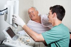 Patient Looking At Ultrasound Machine Stock Photos