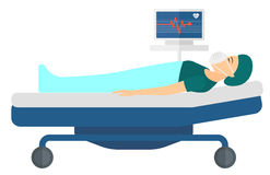 Patient lying in bed with heart monitor Royalty Free Stock Photos
