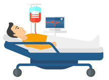 Patient lying in bed Stock Photography