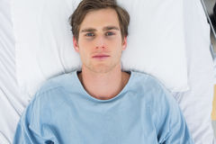 Patient lying in hospital bed Stock Images