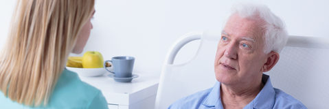 Patient lying in hospital bed royalty free stock photo