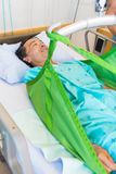 Patient Lying On Sling Of Hydraulic Lift On Royalty Free Stock Photography