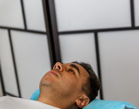 A patient lying on the stretcher of a therapy center Royalty Free Stock Image