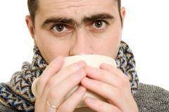 A patient man with a cup. On a white background Royalty Free Stock Image
