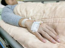Patient man on hospital bed. Patient man lying on the hospital bed Stock Photos