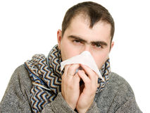 A patient man with a runny nose. On a white background Royalty Free Stock Photos