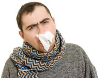 A patient man with a runny nose. On a white background Stock Image