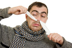 A patient man with a runny nose. On a white background Royalty Free Stock Images