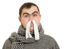 A patient man with a runny nose. On a white background Stock Photo