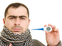 A patient man with a thermometer. On white background Royalty Free Stock Photos