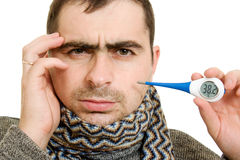 A patient man with a thermometer. On white background Royalty Free Stock Photo
