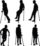 Patient. Man walk on crutches with broken leg Royalty Free Stock Photos