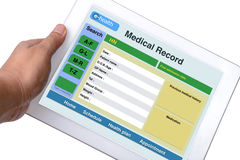 Patient medical record. Patient medical record browse on tablet in someone hand on white background Royalty Free Stock Photography