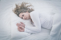 Patient of mental hospital. Lying in bed Royalty Free Stock Photography