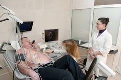 Patient mit cardiologyst Lizenzfreie Stockfotos