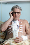 Patient with mobile phone Royalty Free Stock Image