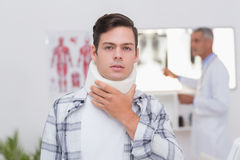 Patient with neck brace looking at camera Royalty Free Stock Photos