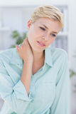 Patient with neck pain Royalty Free Stock Photos