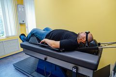 Patient at non-surgical treatment of cervical spine in medical center. Healing man royalty free stock photography