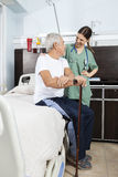 Patient And Nurse Looking At Each Other In Rehabilitation Center Stock Image