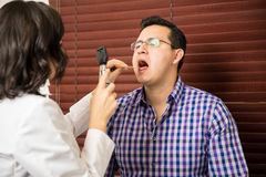 Patient opening his mouth for doctor Stock Image