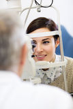 Patient on ophthalmoscope determines eye diopter Stock Photography