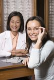Patient And Optician At Optometrists. Portrait of a happy female patient and optician at optometrists Stock Photo