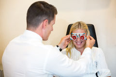 Patient at optometrist with trial frame for test glasses Stock Photography