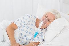 A patient with an oxygen mask Stock Photography