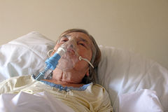 Patient with oxygen mask. Photo of a female hospital patient having oxygen therapy royalty free stock images