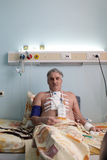 Patient with pacemaker. After heart surgery in a hospital ward stock image