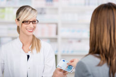 Patient pays for the medicine to the pharmacist Royalty Free Stock Photography