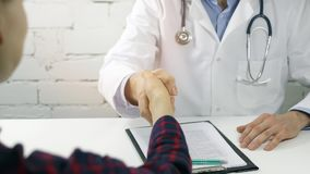 Patient and physician handshake after medical consultation