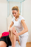Patient at the physiotherapy Stock Images