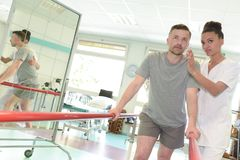 Patient at physiotherapy doing physical exercises using flexi bar Royalty Free Stock Photography
