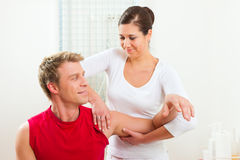 Patient at the physiotherapy doing physical therapy Stock Photo