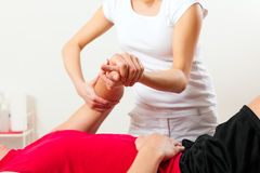 Patient at the physiotherapy doing physical therapy. Exercises with his therapist Stock Photo