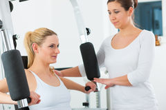 Patient at the physiotherapy doing physical therapy. Patient at the physiotherapy making physical exercises with her therapist Royalty Free Stock Images