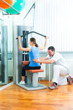 Patient at the physiotherapy doing physical therapy Royalty Free Stock Photo