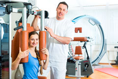 Patient at the physiotherapy doing physical therapy. Patient at the physiotherapy making physical exercises with her therapist Royalty Free Stock Photo