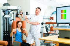 Patient at the physiotherapy doing physical therapy Stock Photography