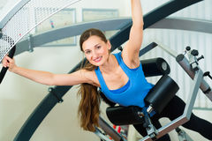 Patient at the physiotherapy doing physical therapy. Space Curl - Patient at the physiotherapy making physical exercises with special equipment Royalty Free Stock Photos
