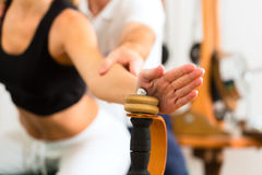 Patient at the physiotherapy making physical exercises Royalty Free Stock Images