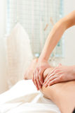 Patient at the physiotherapy - massage. Patient at the physiotherapy gets massage or lymphatic drainage Stock Photo