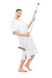 Patient playing on a crutch and dancing Stock Photos
