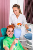 Patient at procedure of teeth whitening Royalty Free Stock Photography
