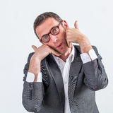 Patient professional touching his bearded face with satisfaction for tenderness. Patient middle aged businessman touching his bearded face with his hands for Stock Photo