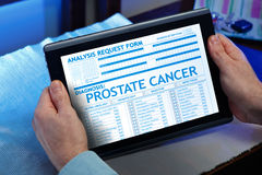 Patient with a prostate cancer diagnosis in his digital medical. Man consulting on the tablet his medical report on the web / Patient with a prostate cancer stock photography
