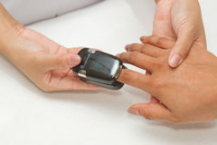 Patient with pulse oximeter Royalty Free Stock Images
